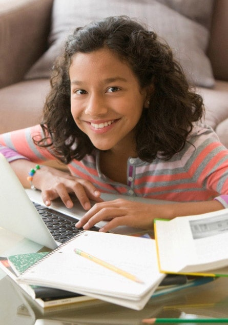 Happy young student home-schooling