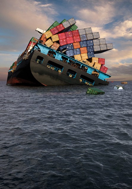 Shipping containers falling off listing ocean vessel.