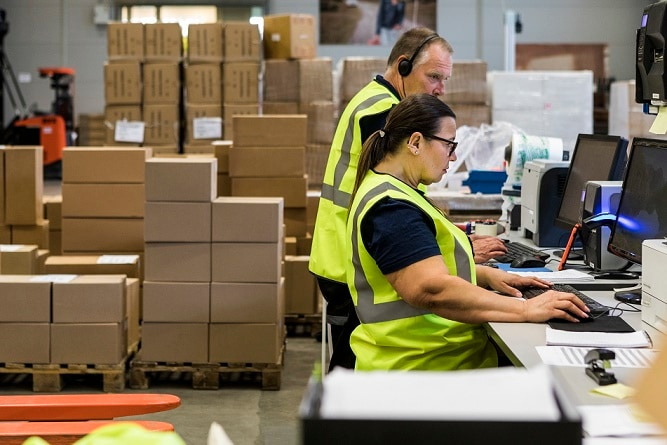 Warehouse employees manage eFulfillment for small and medium-sized companies