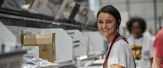 Female worker in medical devices fulfillment operation