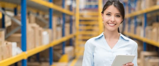 Woman in growing business UPS managing order entry using UPS integrated technology