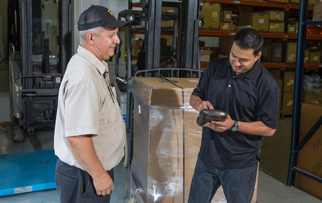 Customer working with UPS freight driver