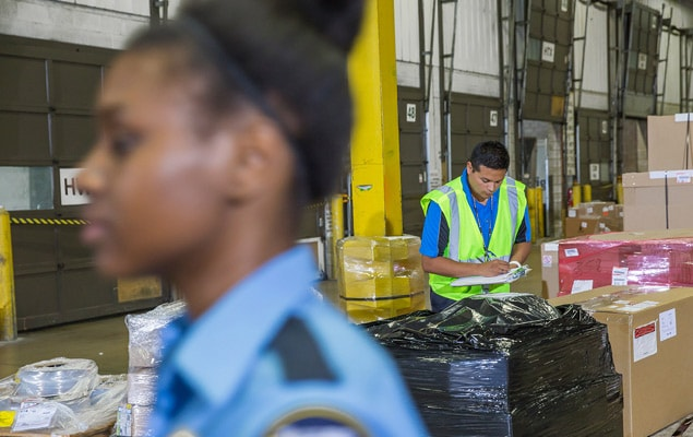 Customs agents clearing shipments in warehouse