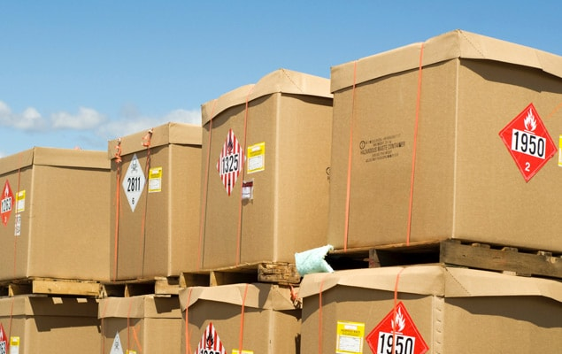 Hazardous materials shipments stacked on pallets