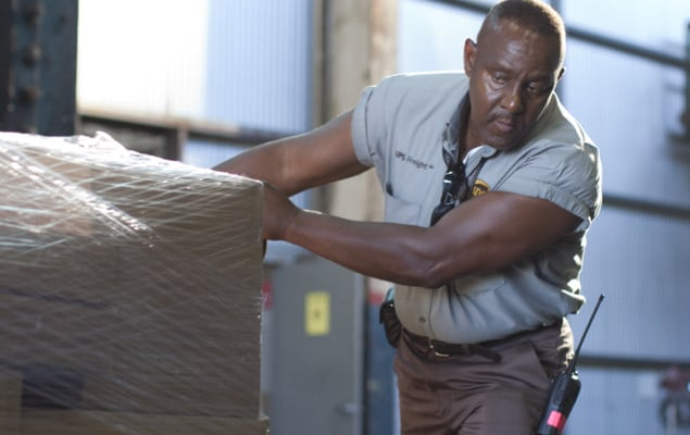 UPS employee handling pallet for LCL shipment