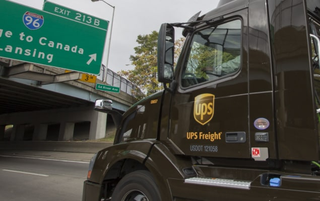 UPS freight truck delivering to customer's warehouse