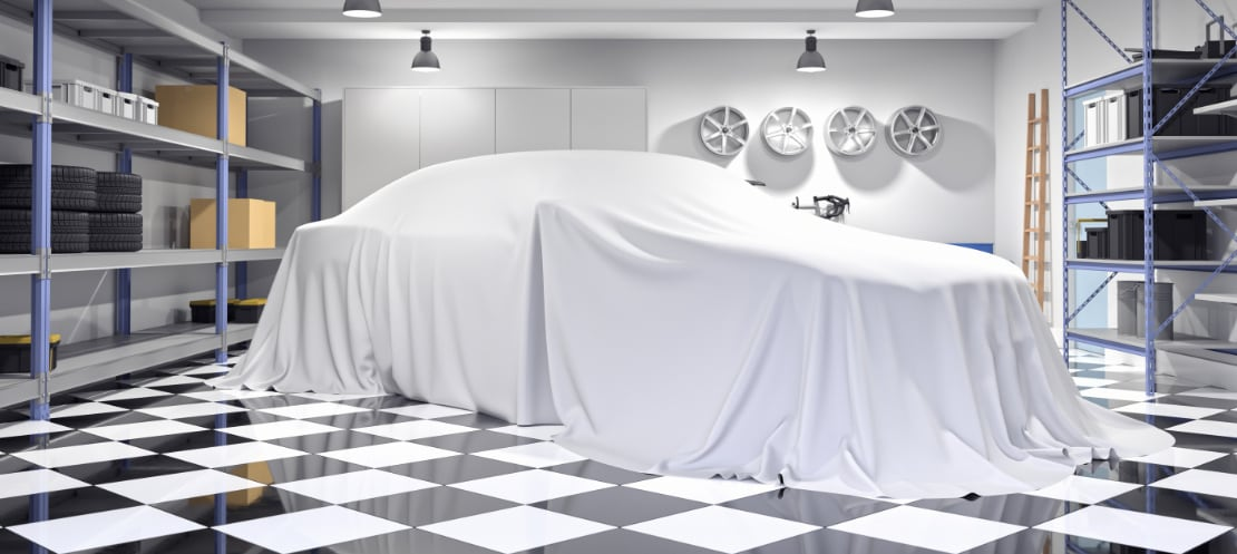 Car under drape on beautiful garage floor